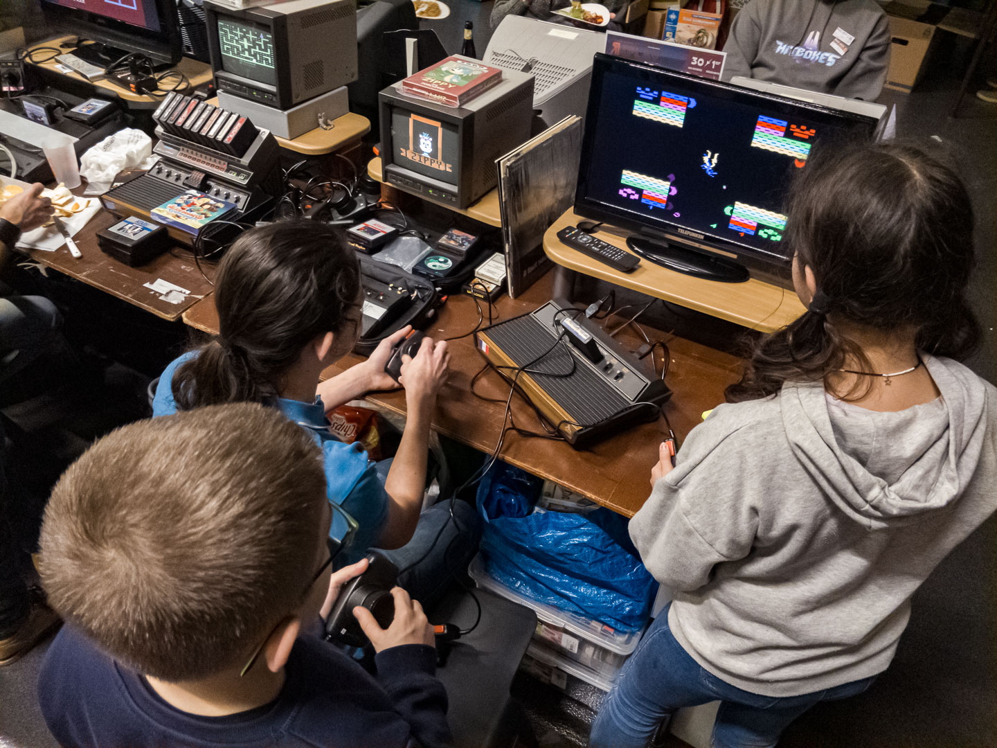 Kids having fun on an Atari 2600